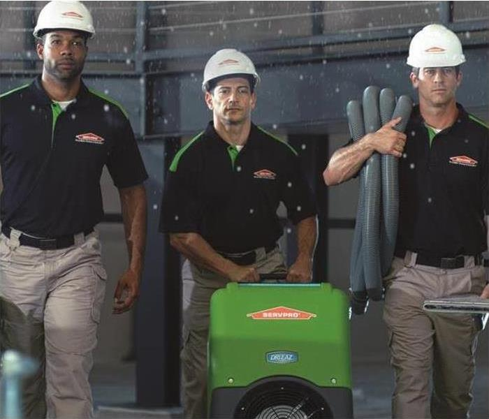 3 Men in SERVPRO shirts during a water damage