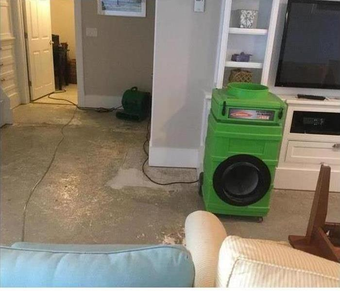SERVPRO drying Equipment set up in living room