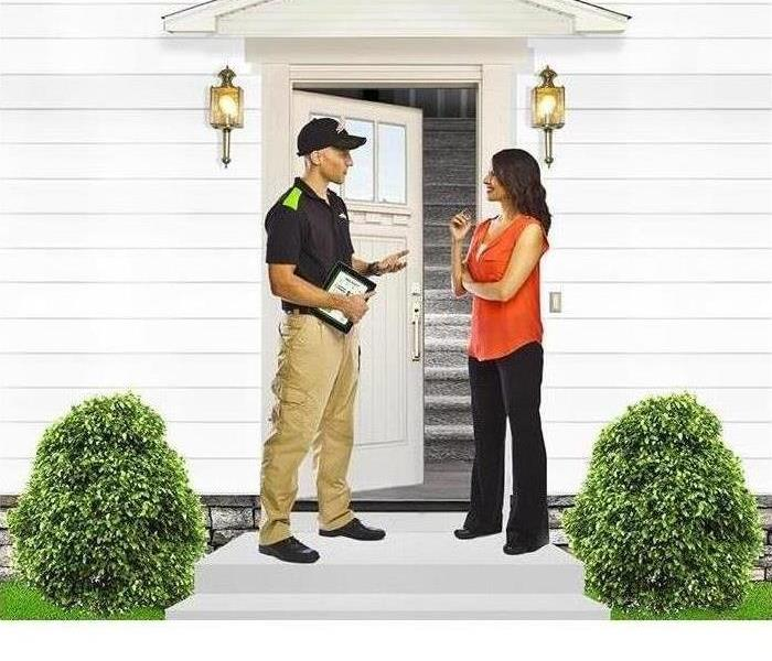 SERVPRO Employee talking to woman at front door