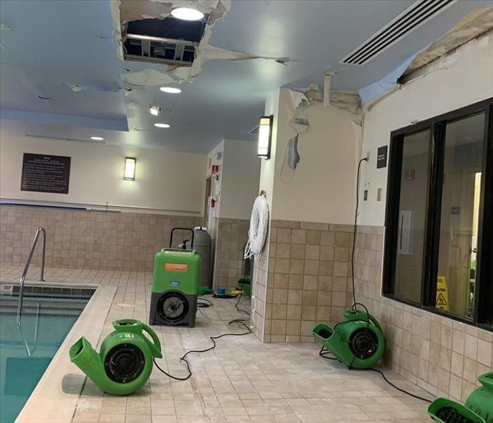Air movers set up in commercial water loss